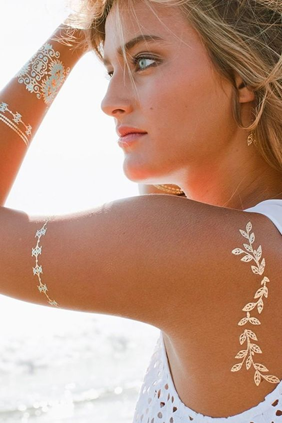 gold henna tattoos on the back, arm. wrist