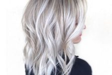 18 medium length silver blonde hair with waves for a refined look