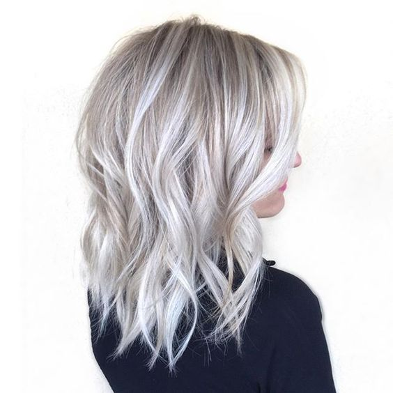 medium length silver blonde hair with waves for a refined look