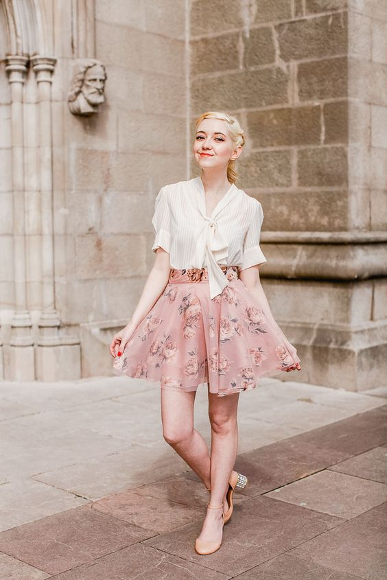 an ivory blouse, a blush floral skirt, nude flats