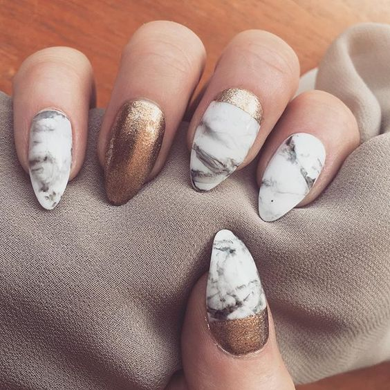 white marble nails and copper accents