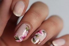 20 nude nails and three of them with pink flowers