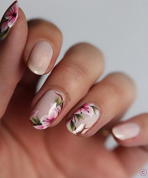 nude nails and three of them with pink flowers