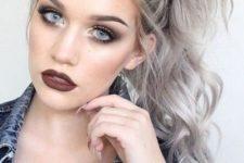 20 wavy blonde grey hair in a ponytail makes a statement