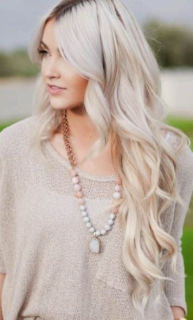 cold icy blonde hair with dark roots and waves