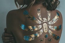 21 scarab and feather gold and black henna tattoo on the back