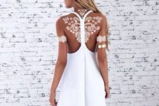 21 white henna tattoo on the back and arms looks like lace