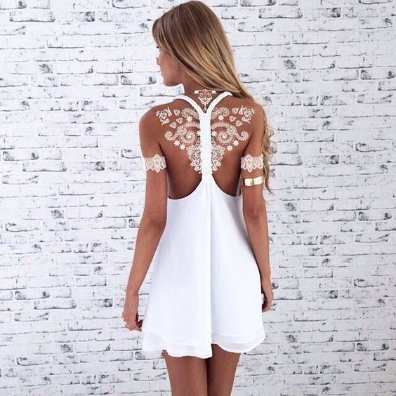 white henna tattoo on the back and arms looks like lace