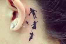 23 black ink Peter Pan tattoo behind the ear