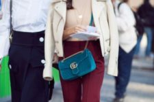 With beige shirt, marsala pants and white jacket