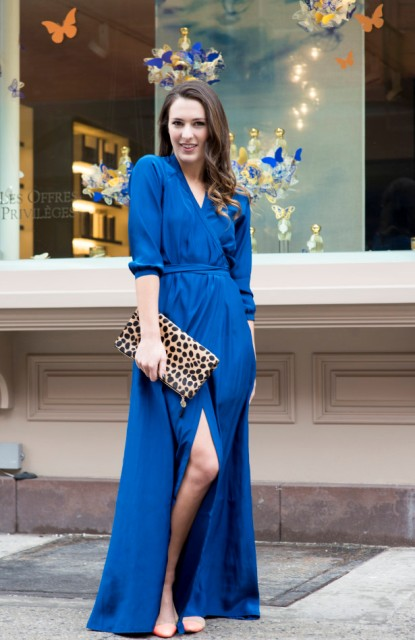 With beige shoes and leopard clutch