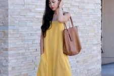 With big brown bag and brown sandals