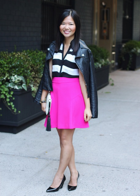 With black and white shirt, leather jacket and black heels