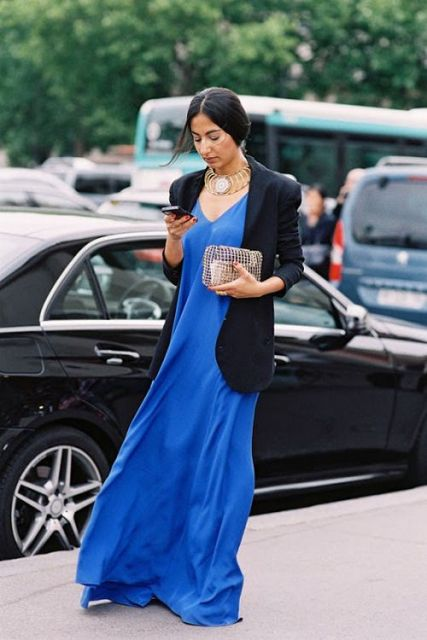 With black blazer, golden necklace and clutch