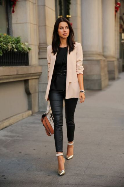 With black blouse, leather pants, metallic shoes and bag