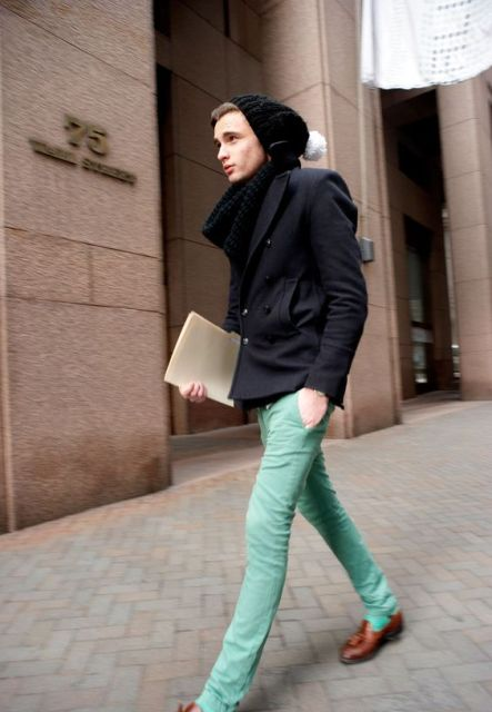 With black jacket, black beanie and brown shoes