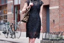 With black lace dress and leopard bag