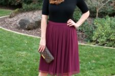 With black shirt, marsala shoes and printed clutch