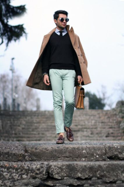 Spring men outfit suitable for work with black sweater, shirt, tie, camel coat and brown bag