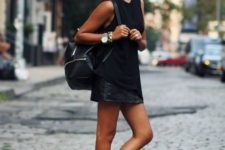 With black top, black leather skirt and backpack