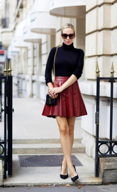With black turtleneck, mini bag and black pumps