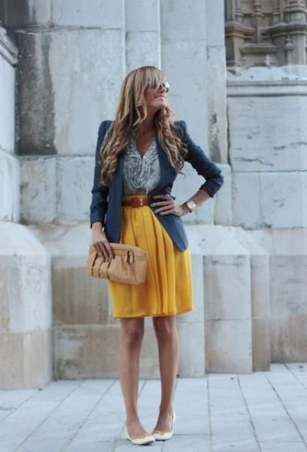With blouse, blue blazer, brown belt, beige clutch and white shoes