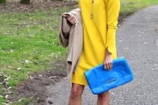With blue clutch and colored sandals