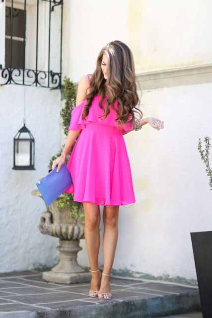 With blue clutch and heels