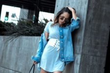 With blue mini dress, denim jacket, sandals and leather bag