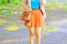With blue shirt, pale pink blazer, ankle boots and brown bag