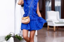 With brown suede lace up sandals and beige bag