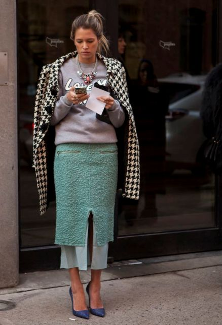 With cool sweatshirt, printed coat and blue shoes