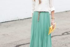 With cream blouse, leopard belt, beige shoes and yellow clutch