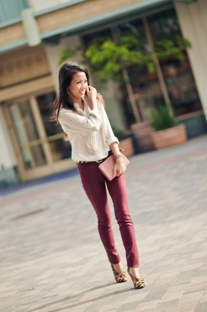With cream shirt, marsala pants and clutch