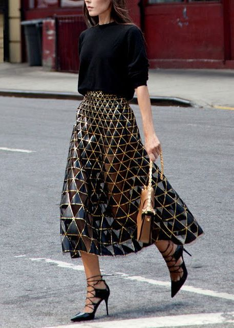 With crop shirt, lace up heels and light brown bag