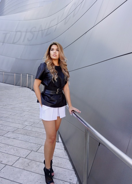 With dark color blouse, white mini skirt and black boots