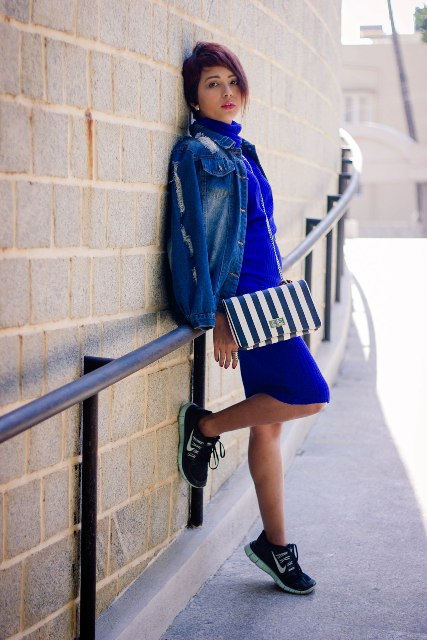 With denim jacket, striped bag and sneakers