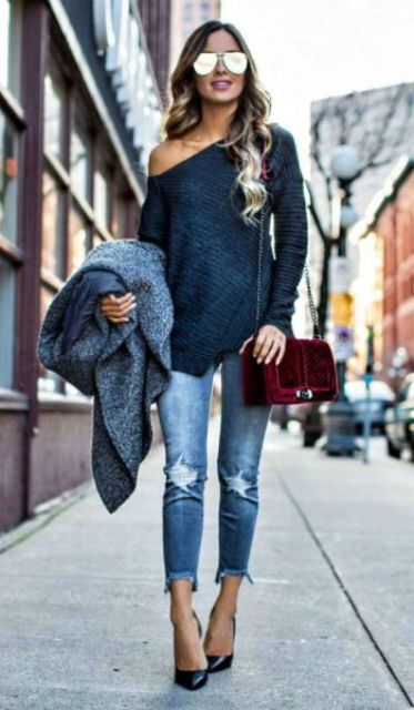 With distressed jeans, black pumps and one shoulder shirt