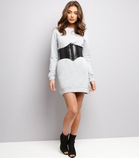 With dress and black suede boots