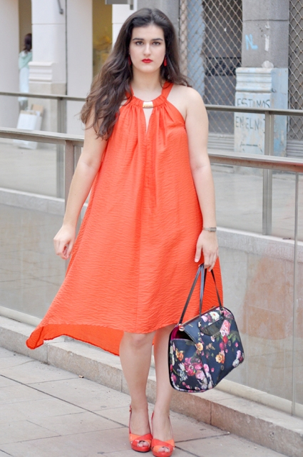 With floral bag and orange shoes
