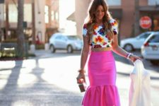 With floral crop top and white heels