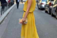 With golden mules and lucite clutch
