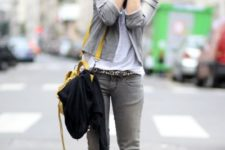 With gray cardigan, gray jeans and leopard belt