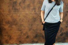 With gray shirt, midi skirt and crossbody bag