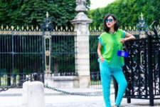 With green loose blouse, turquoise pants and cobalt blue clutch