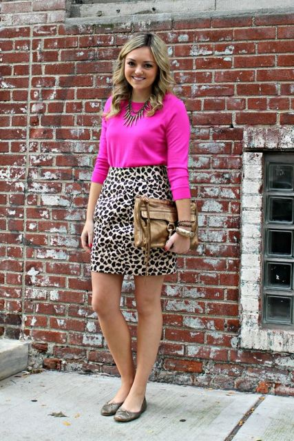 With hot pink shirt, metallic bag and flats