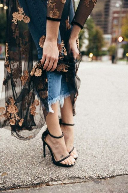 With jeans and black sandals
