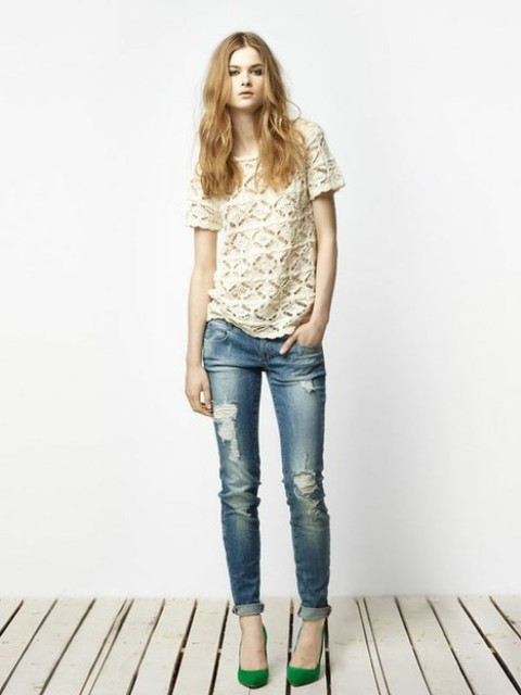 With lace shirt and distressed jeans