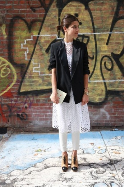 With lace shirt, white pants, ankle boots and black blazer