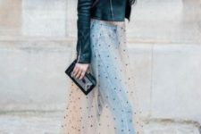 With leather jacket, jeans, black shoes and clutch
